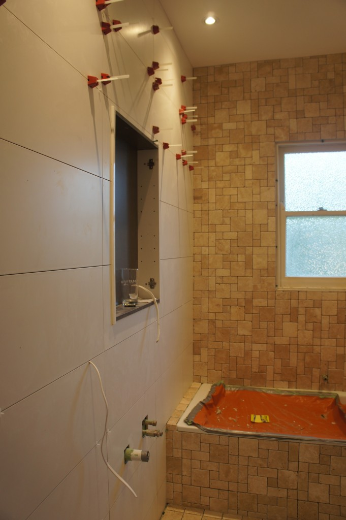 Walls tiled using 300 x 600 White Matte Ceramic tiles.